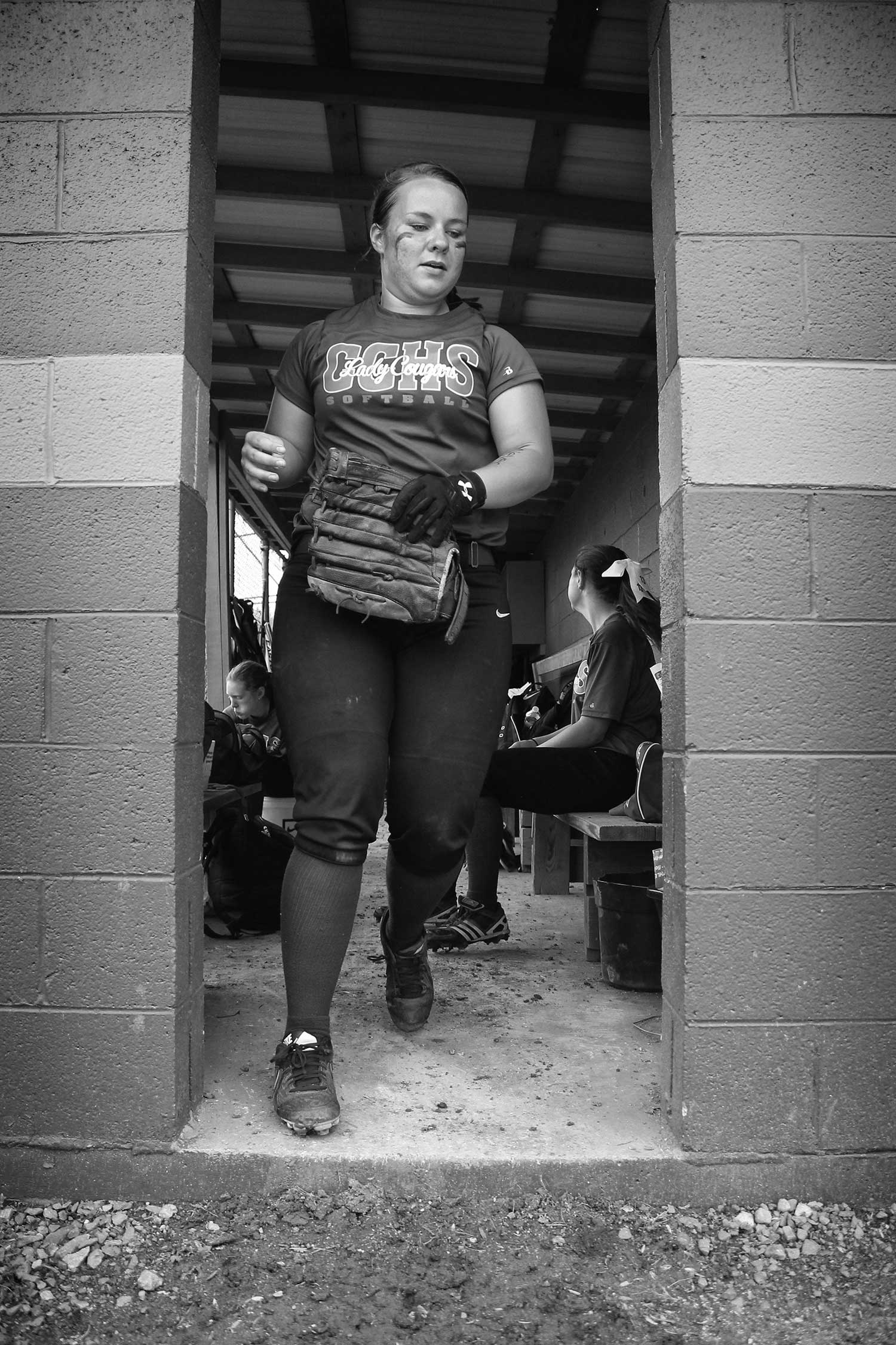 Rachel Holloway, Lady Cougars senior, runs from the dugout in the moments before the team's game against Claiborne County. photo by Emilee Lamb - 2015