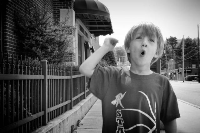 Drake Lively imitates the sound of the toy train he just bought from LaFollette's downtown flea market. photo by Emilee Lamb - 2015