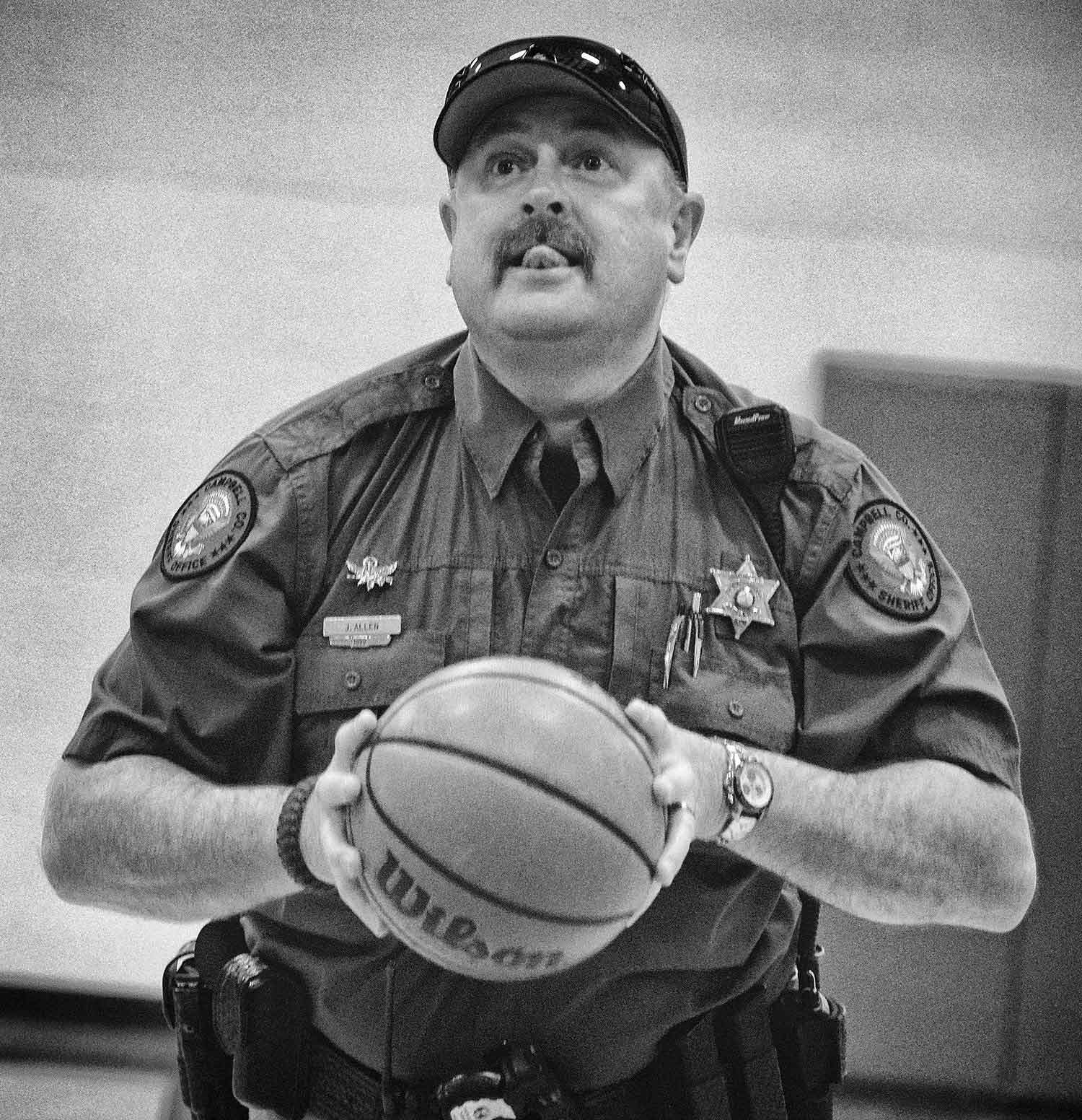 School Resource Offi cer Jeff Allen of the Campbell County Sheriff's Offi ce plays basketball with the Jacksboro Elementary students. photo by Brianna Bivens - 2016