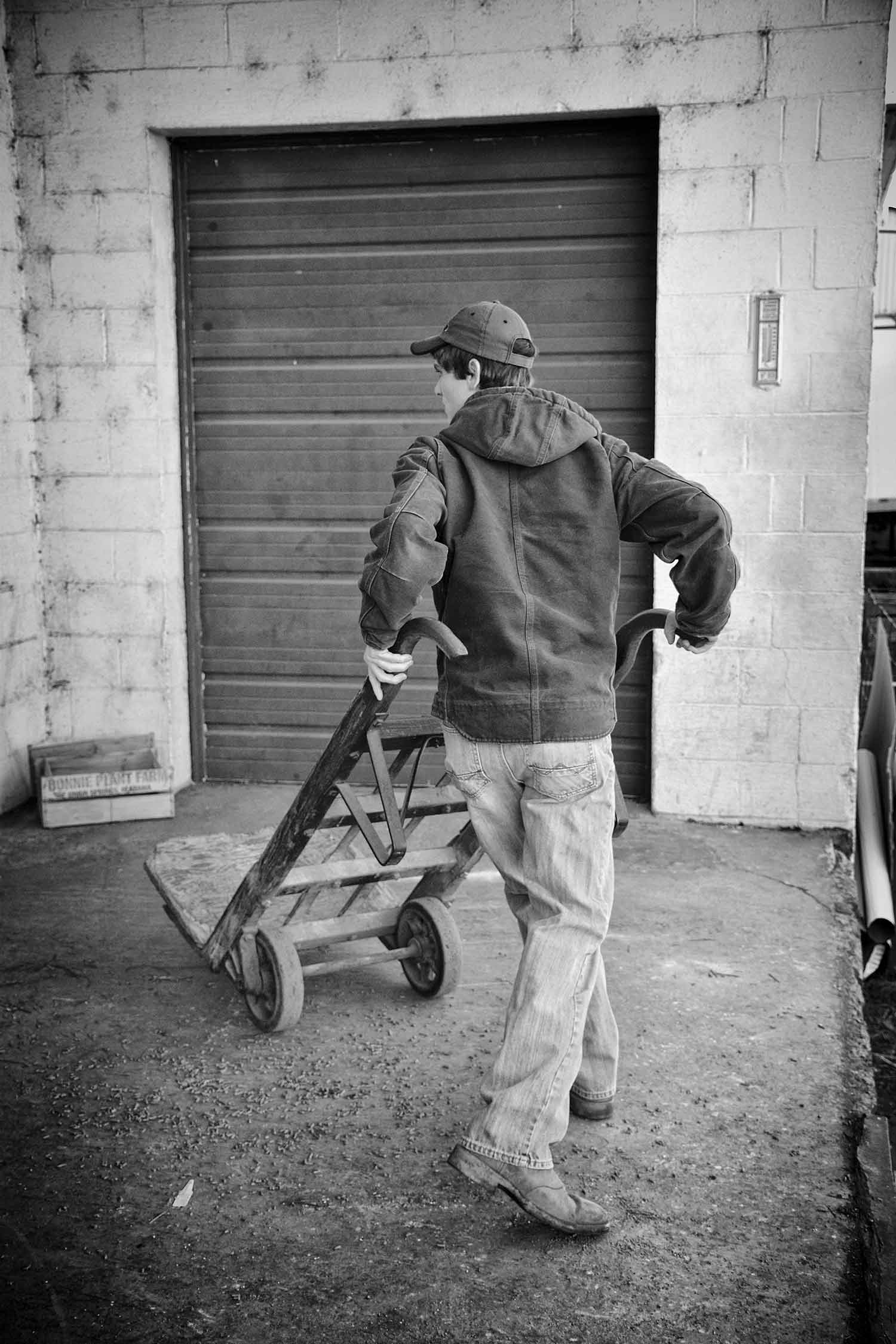 Austin Phillips kindly greets and loads grain for customers at the Co-op on Saturday mornings. photo by Cameo Waters - 2016