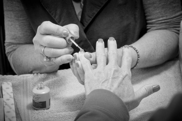 Susie Nelson paints nails at the Xpress Salon. photo by Emily Ross - 2016