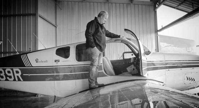 Lynn Prater admires his plane of 8 years.  photo by Emily Ross