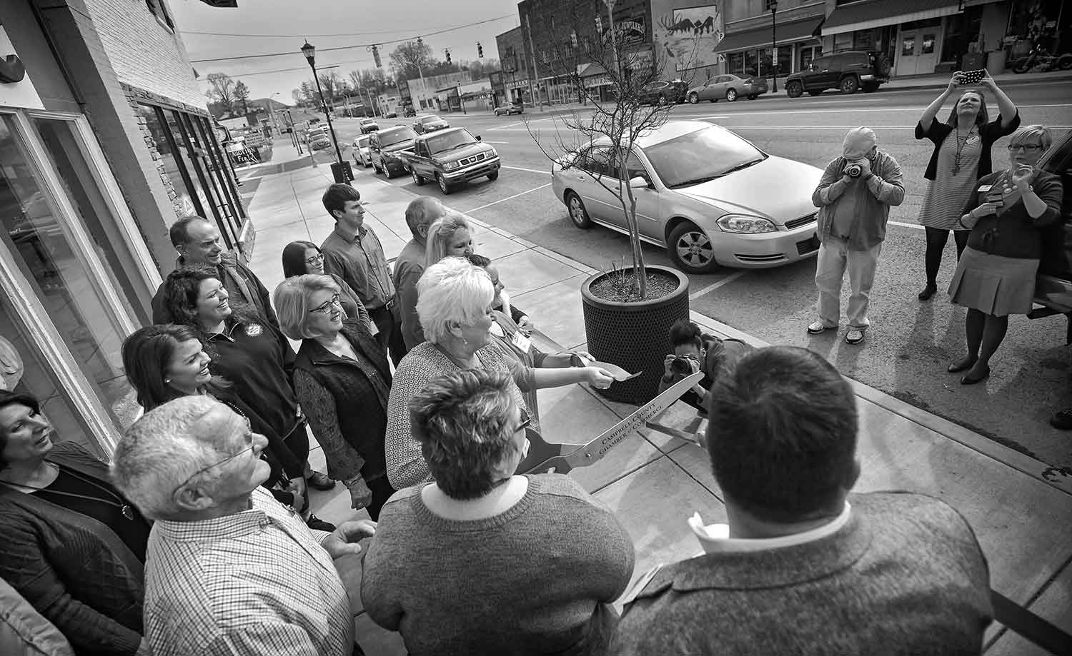 LaFollette community members convene for the ribbon cutting ceremony at the Habitat for Humanity Resale store. photo by Austin Perryman - 2018