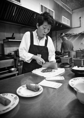Lori Chao prepares a fried pork cutlet for her Tonkatsu dish at the Takumi Japanese restaurant. photo by Caitlyn Jordan - 2019