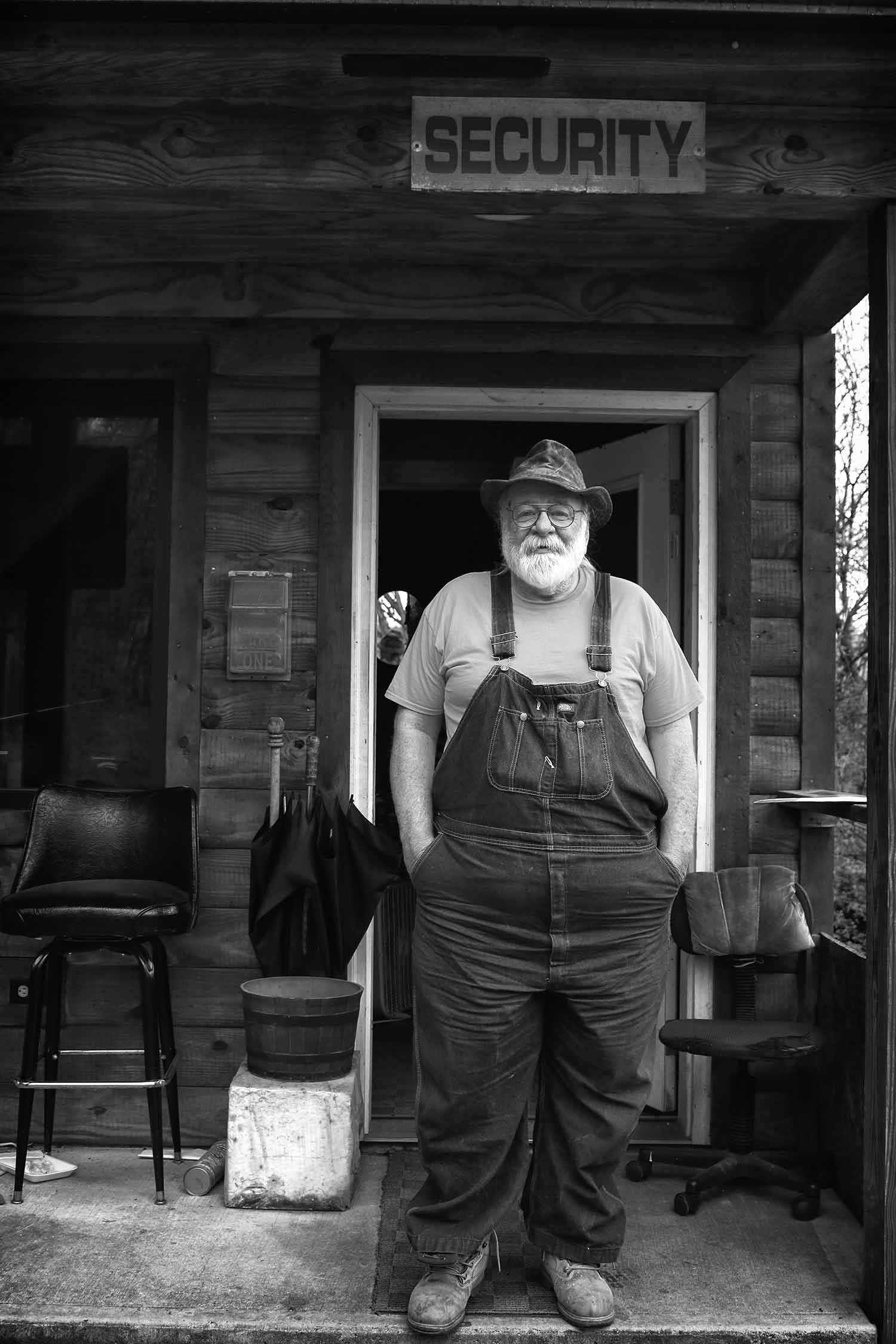 Clyde Brantley, head of security for the community at McCloud Mt. Restaurant and Lodge, stands watch at the gate. photo by Sarah Plemmons - 2019