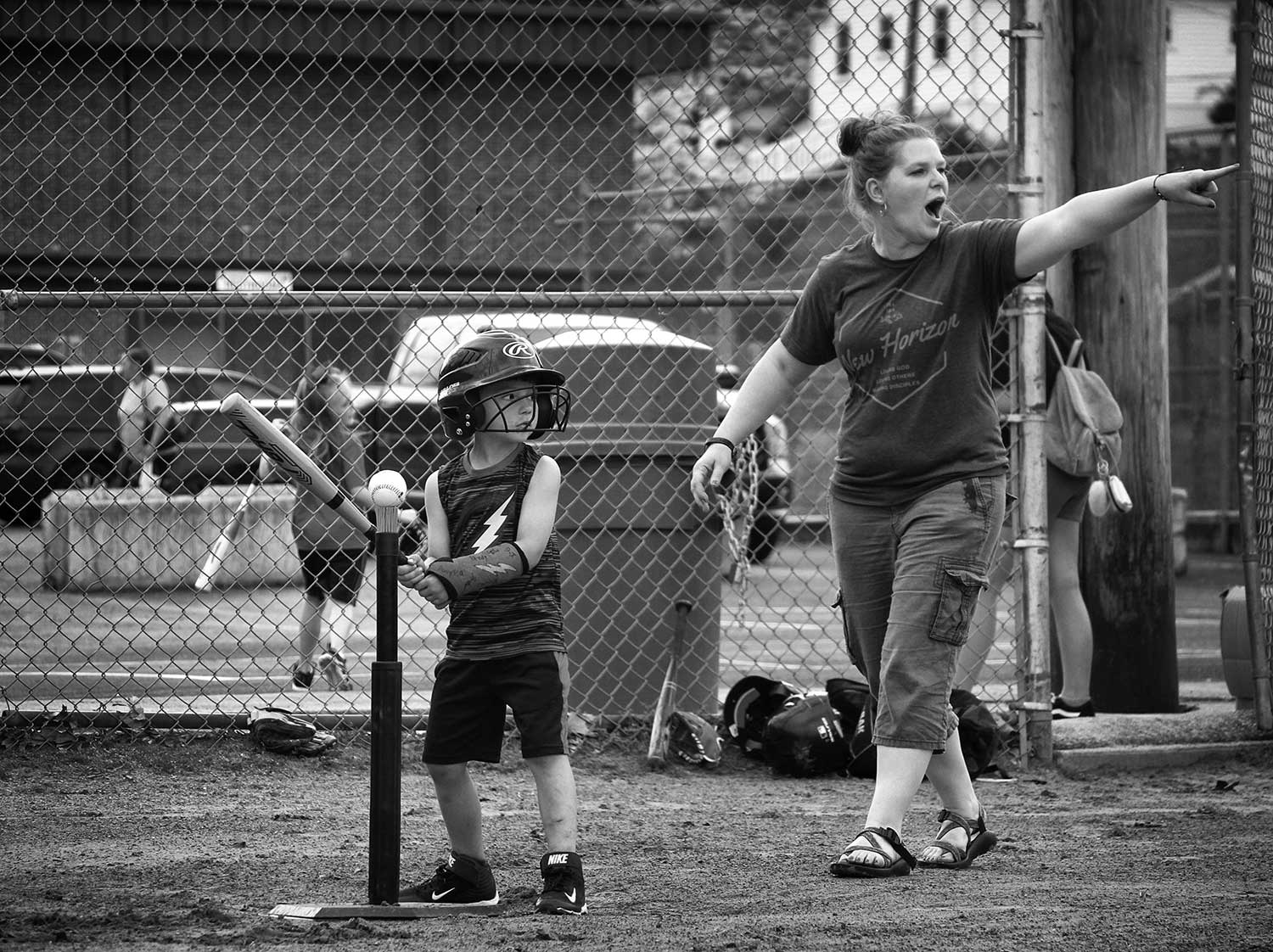 """Wildcats coach Tabby Ivey instructs the infield to be """"baseball ready"""" for Nathan Jones' big swing. """"This is only our second practice so we're trying to learn the names too,"""" said Tabby's husband Craig. photo by Seth Raborn - 2019"""