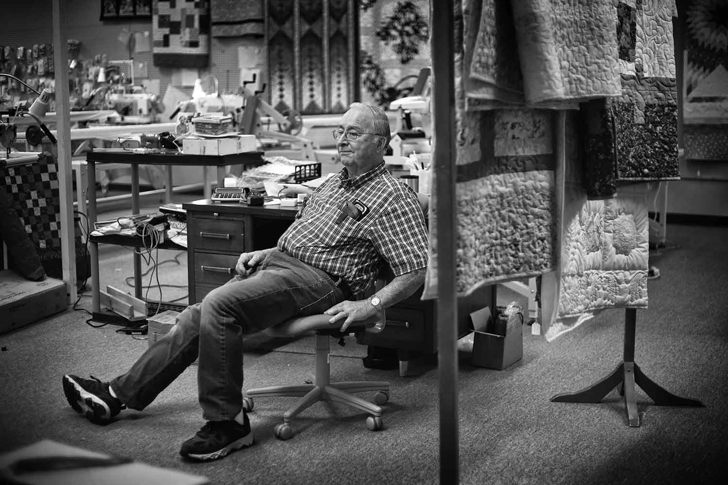 """Wayne Morgan, owner of The Quilt Patch. Wayne and his wife, Joyce, opened the store over 12 years ago after retiring from previous professions. They """"didn't retire well"""" and refused to be bored. photo by Kellie Ward - 2019"""