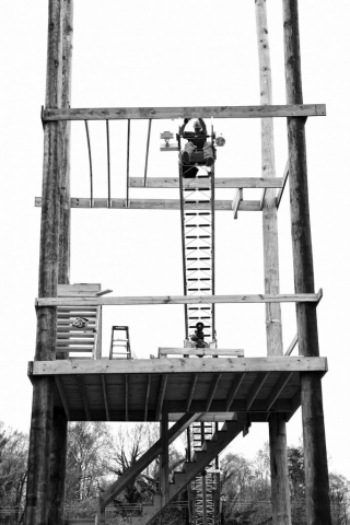 Assistant fire chief Jimmy Pack works on constructing a fire tower for training firefighters. photo by Kellie Ward - 2019