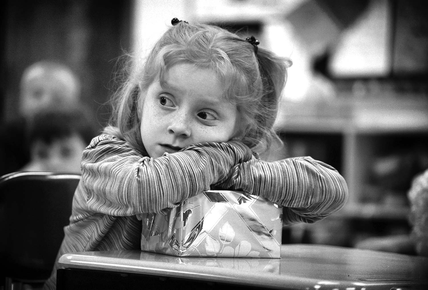 First grader, Meghan Brumitte, looks on expectantly as she waits to see if her classmate's egg protection box was a success. Photo by Jessica White - 2003
