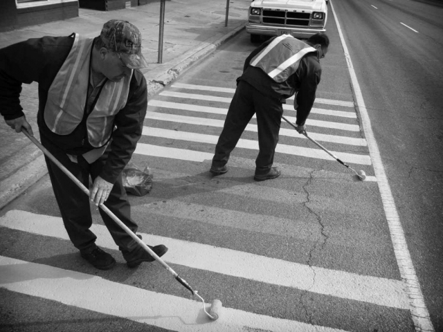 Ray Bostic and Tony Huddleston repaint the no-parking zone on Highway 25 at the corner of Tennessee Avenue. photo by Steve Metz - 2004