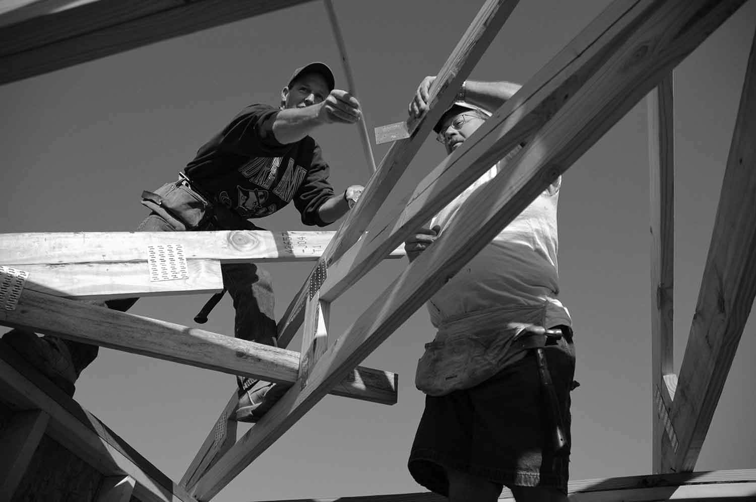 Steve Steffens, left, and Mike Hart take roof measurements for a new restroom building and tool room at Shanghai Resort marina. photo by Josh Battle - 2005