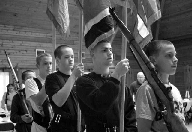 (left to right) Robert Sopha. James Olson, John Stooksbury, Chad Gilliam and Will Morris rehearse the color guard for the JROTC Military Ball. photo by Grace Wade - 2007