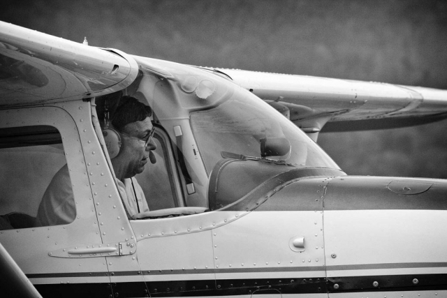 When he's not flying business jets, Bert Loupe can usually be found managing Campbell County airport. This quiet Friday afternoon provides him the opportunity to roll one of the planes onto the tarmac for a brief flight beneath the grey sky. photos by Jamie Wilson - 2007