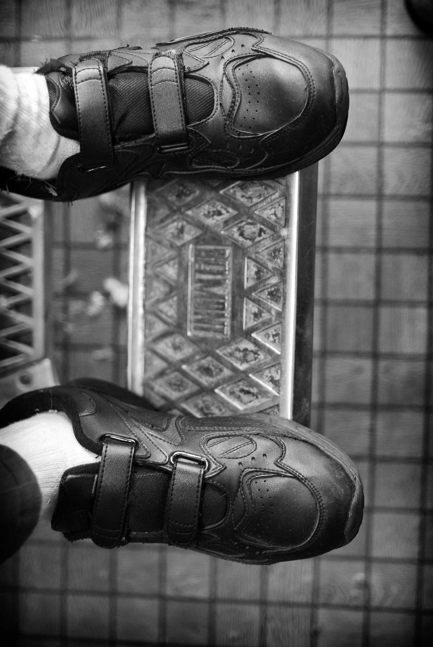 Granville Cornett's shoes reflect the classic style of Ray Beeler's barber chair. Photo By Samantha Thornton. - 2008