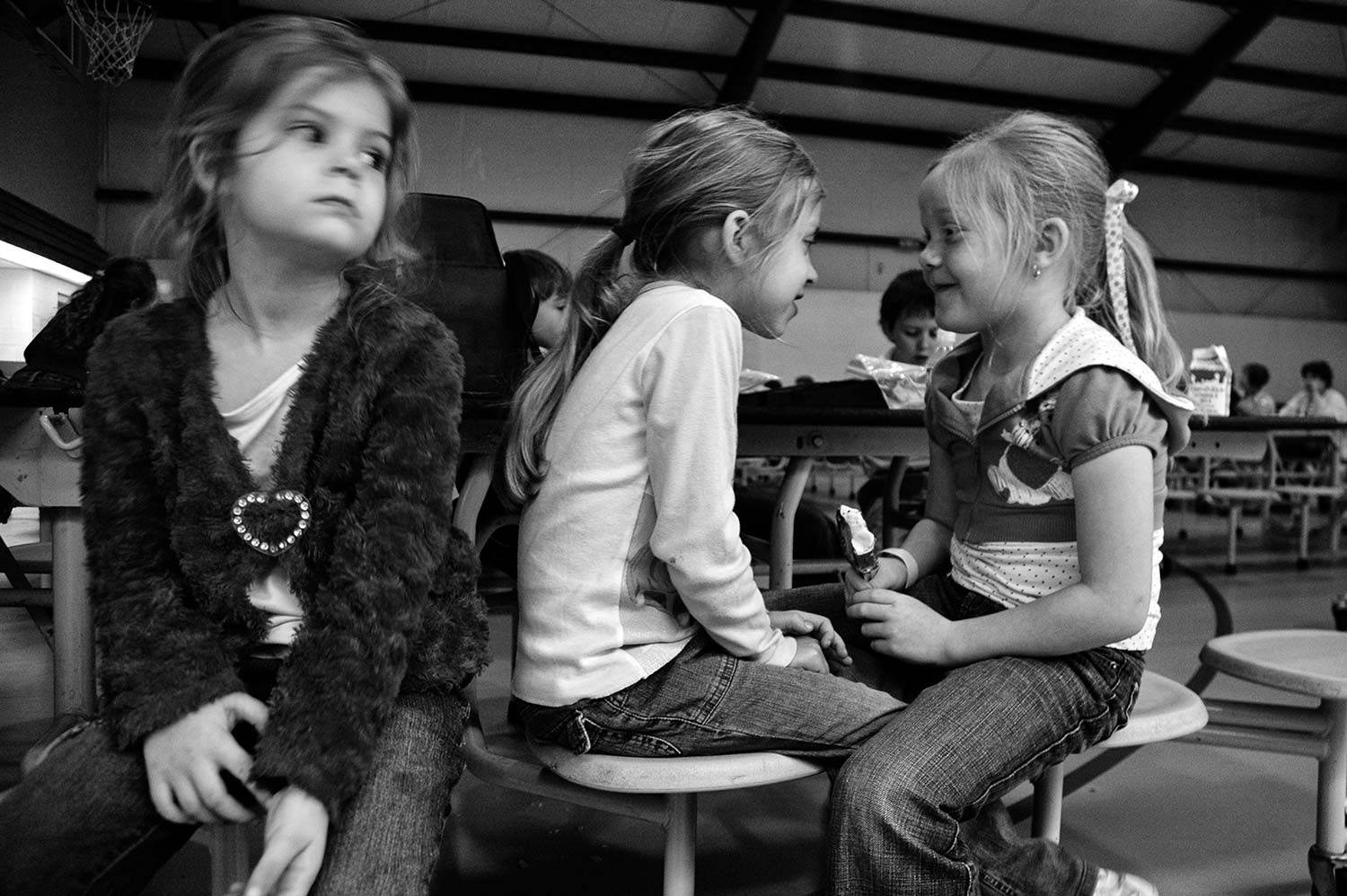 Sarah Lewis, Taylor Bell and Madison Spradlin, kindergarten students at the Christian Academy of Campbell County, wait for their ice cream at lunchtime. Photo By Erin Hatfield. - 2008