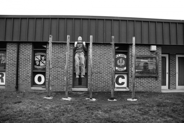 Cameron McDonald demonstrates the use of the ROTC pull-up bars in front of the ROTC room. He does about ten without breaking a sweat. photo by James Bolton - 2009