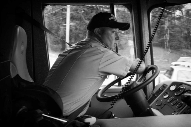 Tony Claborn prepares to make a turn in a fire truck while driving down the streets of LaFollette. photo by Mark McNabb - 2009