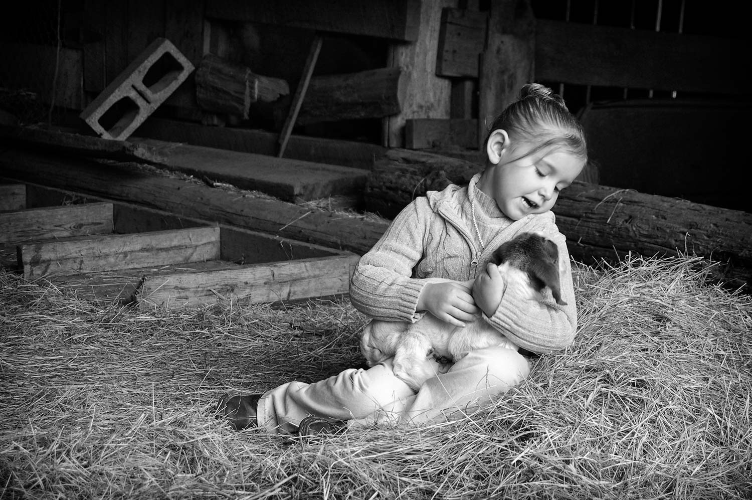 Kaitlyn Roop likes to visit her neighbor's newborn goats. photo by Allison Eskew - 2009