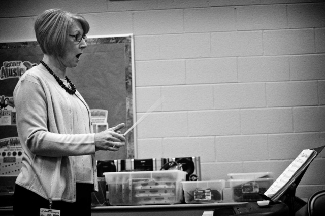 Martha Freeman directs a fifth grade class, which is preparing for an upcoming choral performance. photo by Jordon Vest - 2009
