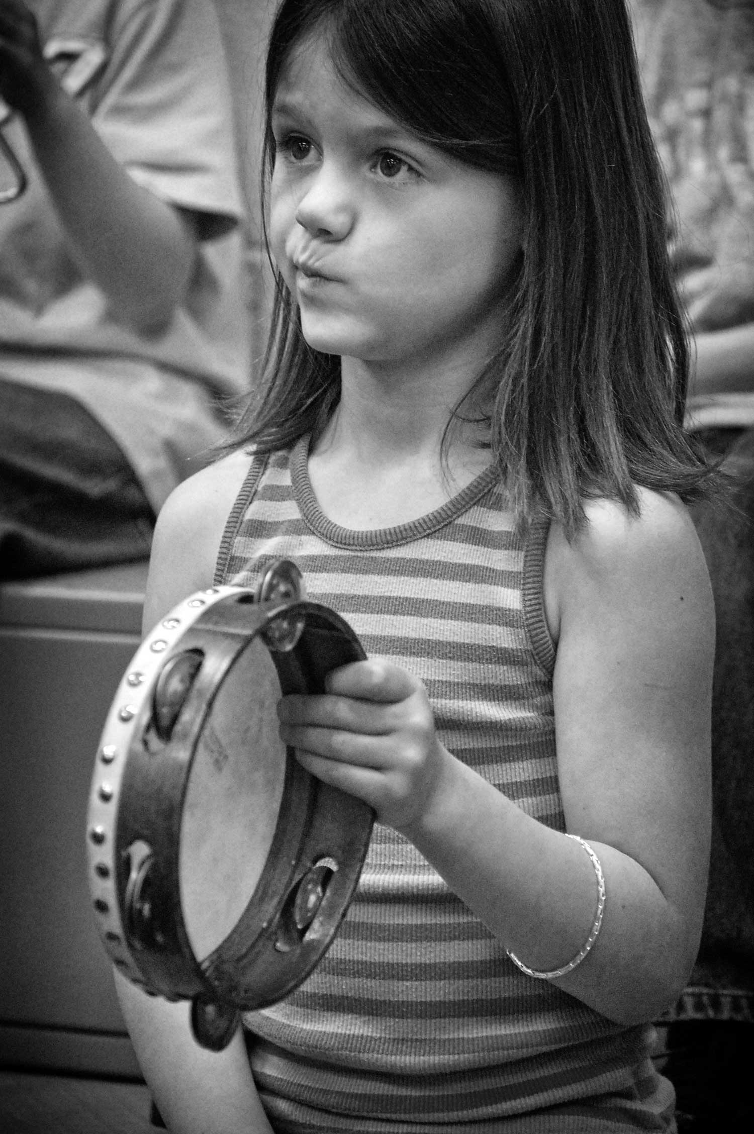 Second grader Samantha McNay concentrates while playing the tambourine in Freeman's music class. - 2009