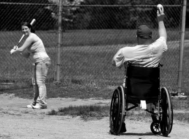 Ronald Reagan pitches the ball to Holly Bullman. photo by Katie Geisberger - 2010