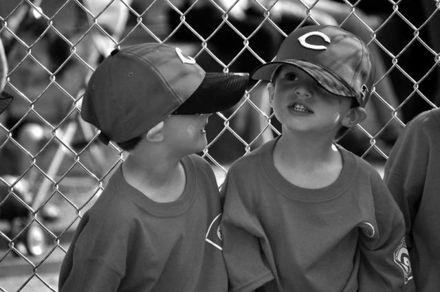 Little League players Brady Hatmaker (left) and Hudson Harris (right) await the start of their tee ball game. photo by Jonathan Barrow - 2010