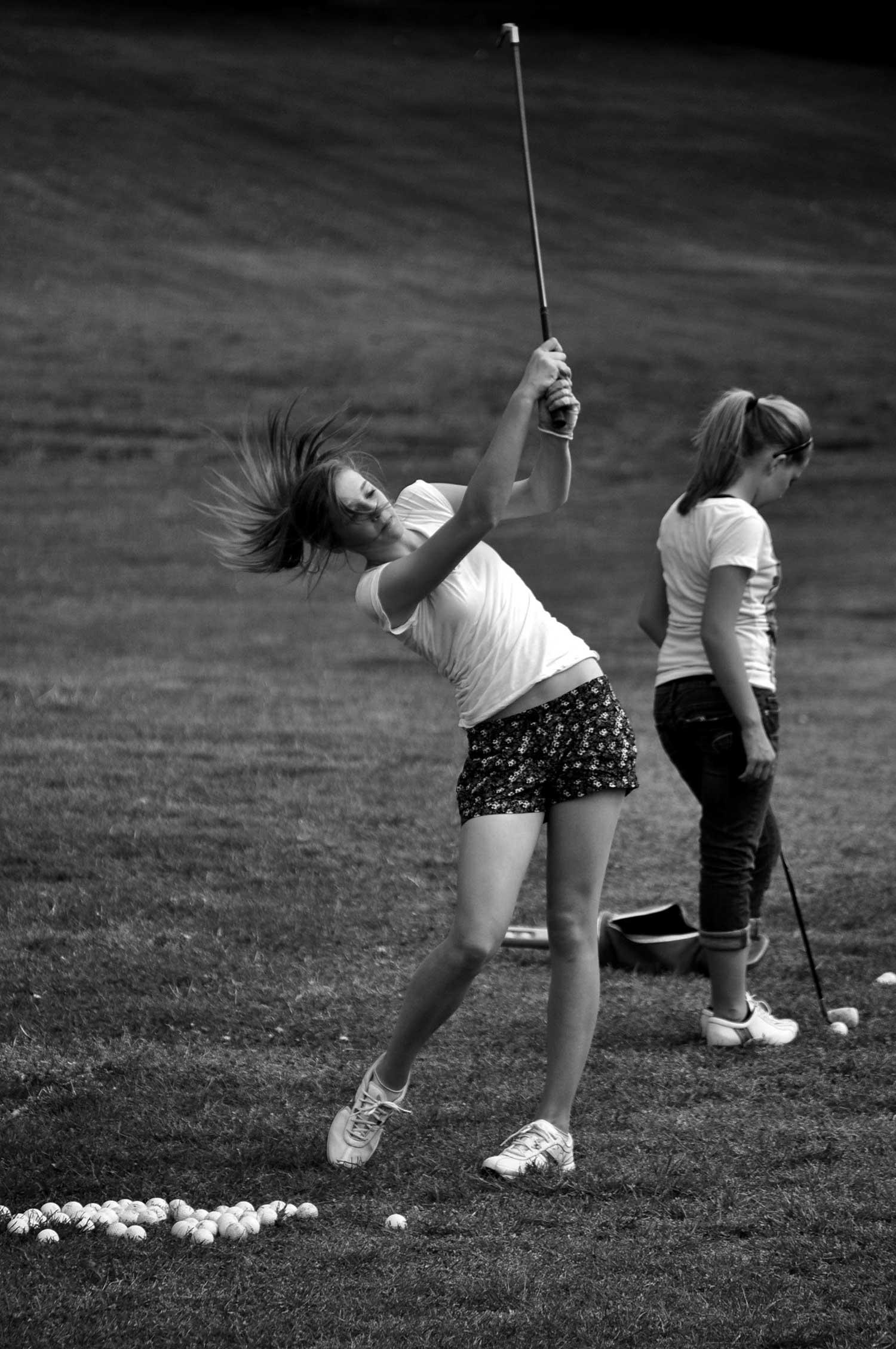 Marie Roach (left) Rachel Heatherly (right) practice their swings. photo by Jonathan Barrow - 2010