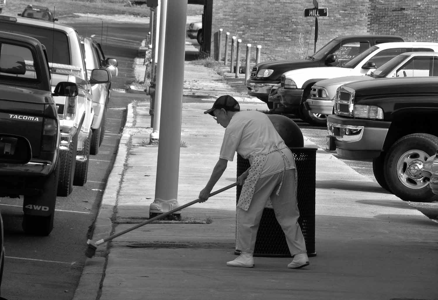 Mildred Weldon sweeps a sidewalk on Tennessee Ave. photo by Jonathan Kahler - 2010