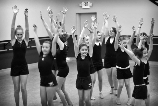 Fingers fl y as students from Imagine Dance Studio practice a sequence from Hairspray. photo by Ashley McClusky - 2011