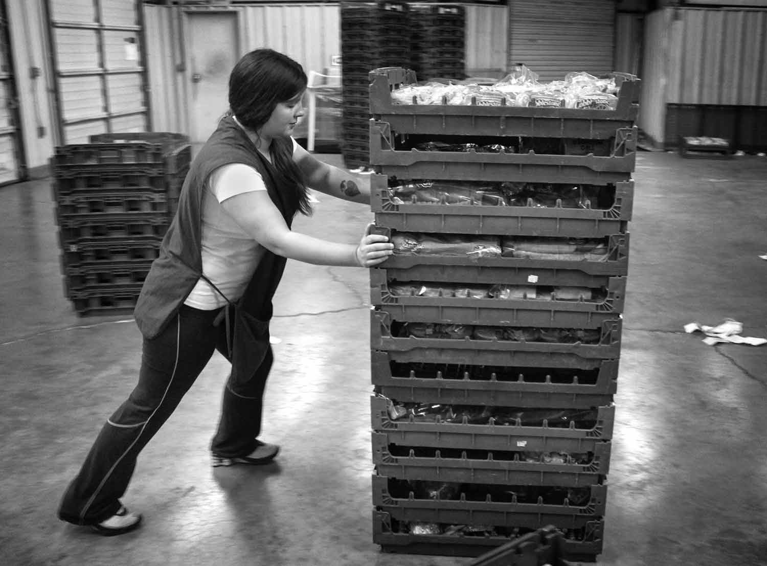 Carol Longmire pushes bread to be sold at Flower's discount bakery store. photo by Michael Agreda - 2013