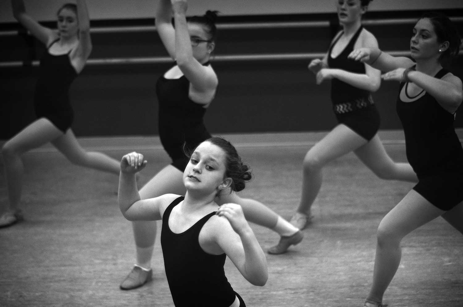 Ashley Tierney and her fellow classmates practice a routine. photo by Logan White - 2014