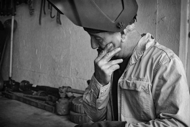Kim Myers ponders before a welding job. photo by Ben Murphy - 2014