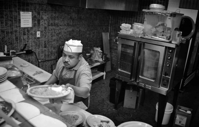 Felipe Corria prepares lunch dishes at El Pueblito Mexican restaurant. photo by Ellyn E. Fulton - 2014