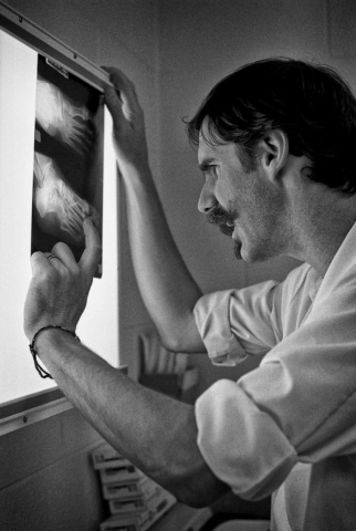 In the hospital emergency room,Dr. John Pillow studies an x-ray of a possible fracture. Photo by Carol Morgan - 1995