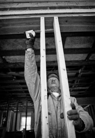 Wayne Eubanks of Jacksboro prepares to install a window. photo by Cory Soldwedel - 1999