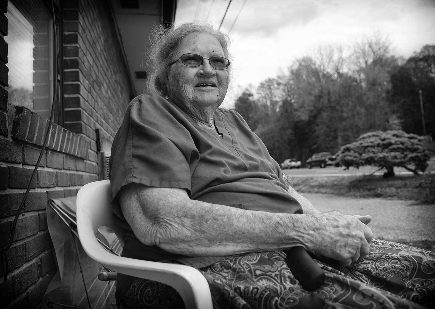 Florene Brown enjoys the day relaxing on her friend's front porch on the Old Jacksboro Highway. photo by Caitlyn Jordan - 2019