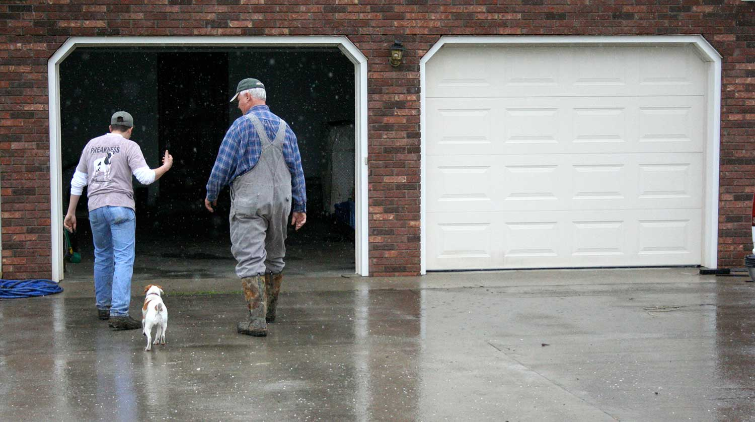 Matt Mitchell and his grandfather, Ronald Greene, talk about the farming and about the rain. photo by Brandon Ball - 2008