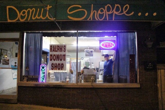 The clock strikes 4:30 a.m. as two student photographers emerge from the morning dusk to greet Tina Baird. Baird has agreed to give her guests the chance to view life through her eyes as she opens her donut shoppe.  photo by Olivia Johnson - 2017