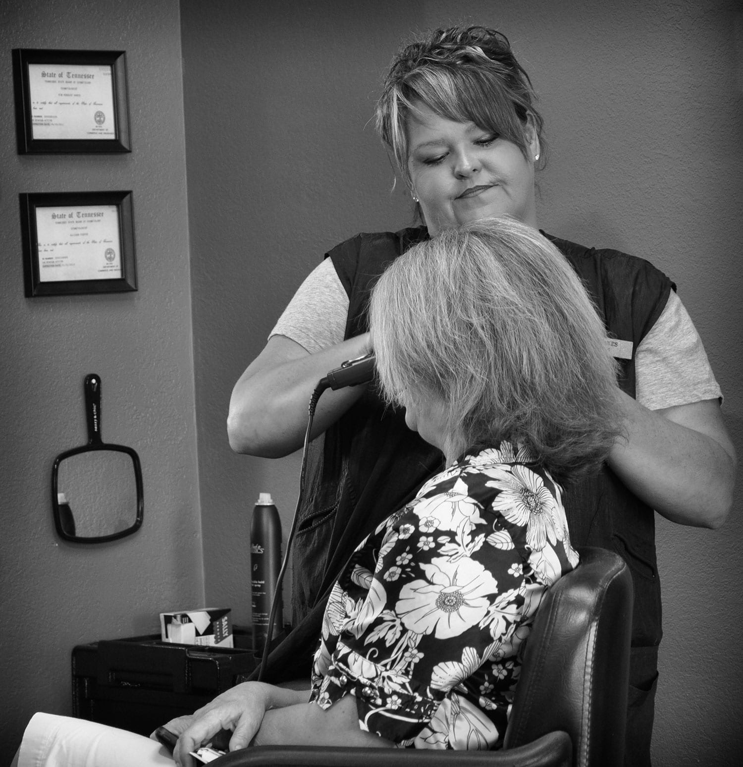 Sixth grade teacher, Kim Fairchild, relaxes at Villa Salon as Kim Oakes styles her hair. photo by Anne Huffman - 2010