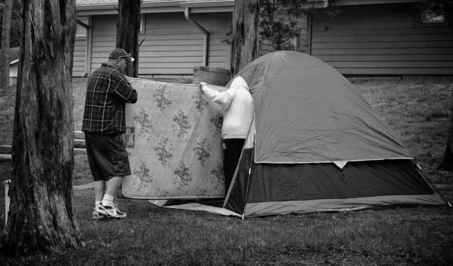 Shane Humerick and Brittany Partin set up their tent in Cove Lake Park Campground. photo by Ben Moser - 2009
