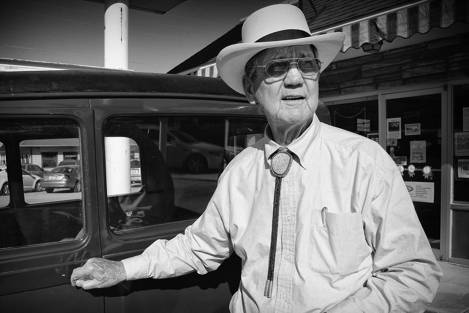 """Iconic LaFollette resident, businessman and auctioneer, """"Hack"""" Ayres has deep roots within Campbell County. He can be spotted around town wearing a tall, white straw hat and driving a bright-yellow truck. photo by Lauren Beets - 2013"""