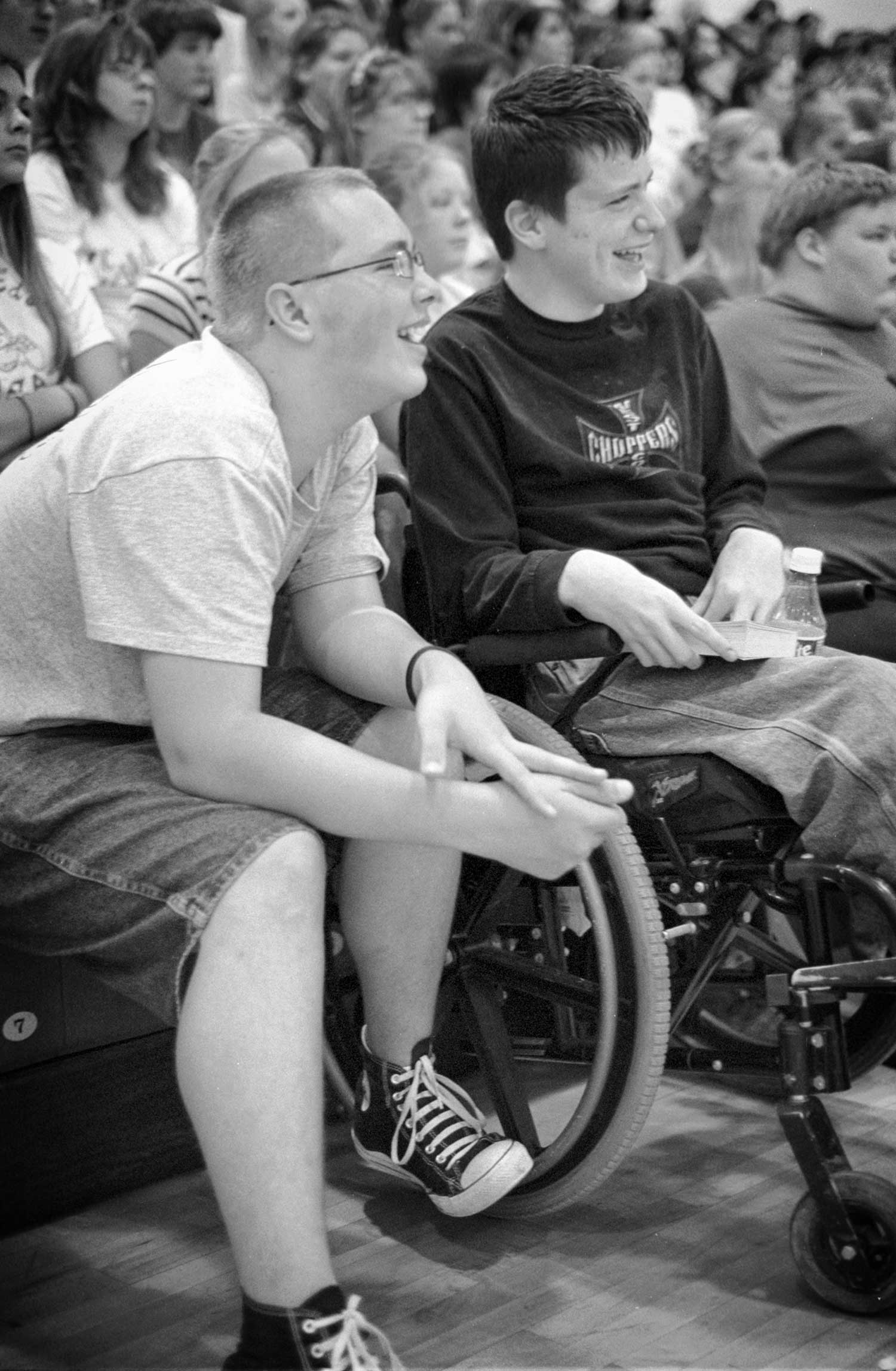 Nick Thacker, left, and Craig Whicker,eighth graders at Jacksboro Middle School, enjoy the show by Twist 'n Shout gymnasts. photo by Zach Zoeller - 2005