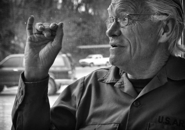 Carl Rutherford tells his stories of the Vietnam War while sitting at the same table he has sat at for 6 years in Rainbow Family Restaurant. photo by Alexandra Harper - 2014