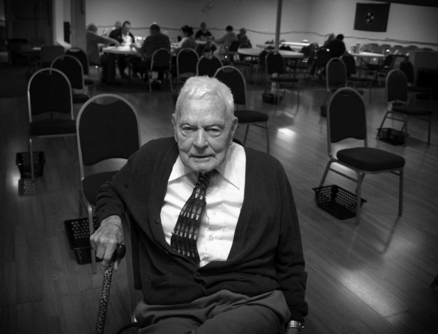 A veteran of three wars, William Morton, known as Colonel, waits for the silver sneakers class at the Senior Center. photo by Natasha Zalewski - 2014