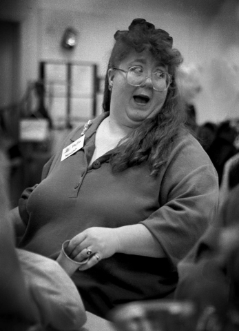 Phyllis Booth, manager of the Goodwill, laughs it up during the Teddy Bear Brigade. photo by Jessica Bocko  - 1997