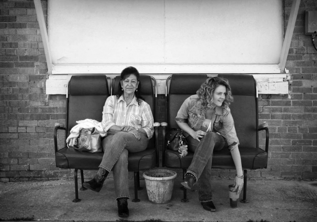 MJ Reed and Brittany Pruit wait outside Country Tyme for a band performance. photo by Hannah Cather - 2013